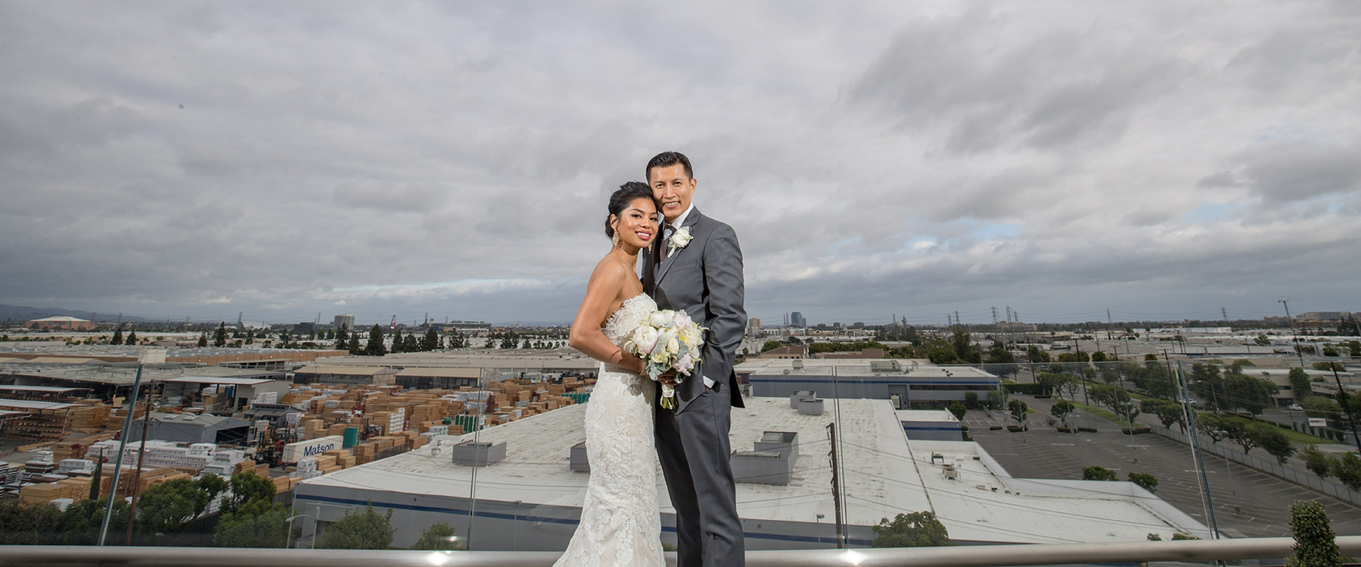 Bride and groom pictured on the balcony