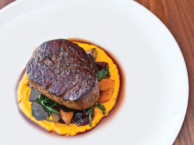 30-ounce steak prepared New York Delmonico-style served over a bed of steamed vegetables in a rich sauce.